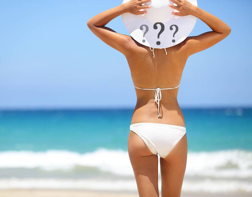 Woman on beach with question marks illustrating frequently asked questions